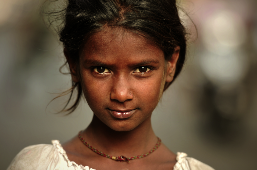 An Indian girl is photographed on the street in southern Mumbai, India. In India irrespective of the caste, creed, religion and social status, the overall status of a woman is lower than men and therefore a male child is preferred over a female child. A male child is considered a blessing and his birth is celebrated as opposed to a female child where her birth is not celebrated and is considered more of a burden.