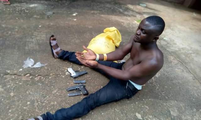 Man Caught in Obudu Motor Park With Pistols And Magazines Buried In A Bag Of Garri (Photos)