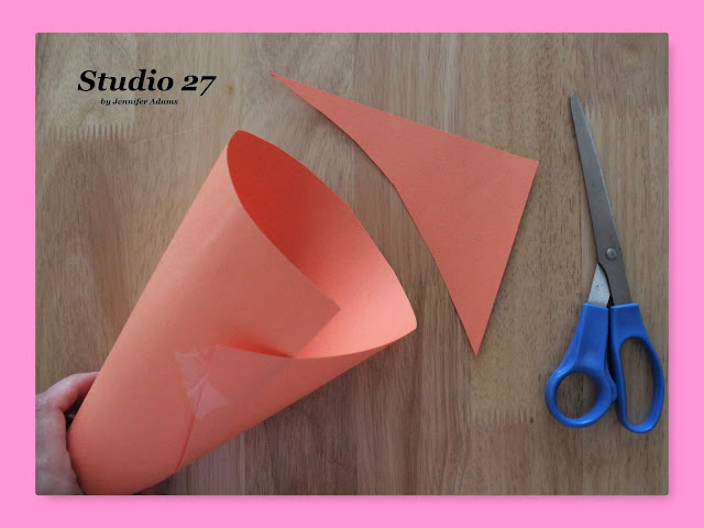 Trimming the construction paper cone template