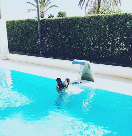 Mikel obi and his babymama cuddle inside a pool in new for Obi filtersand pool