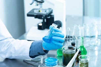 Scientist in laboratory making vaccine for virus