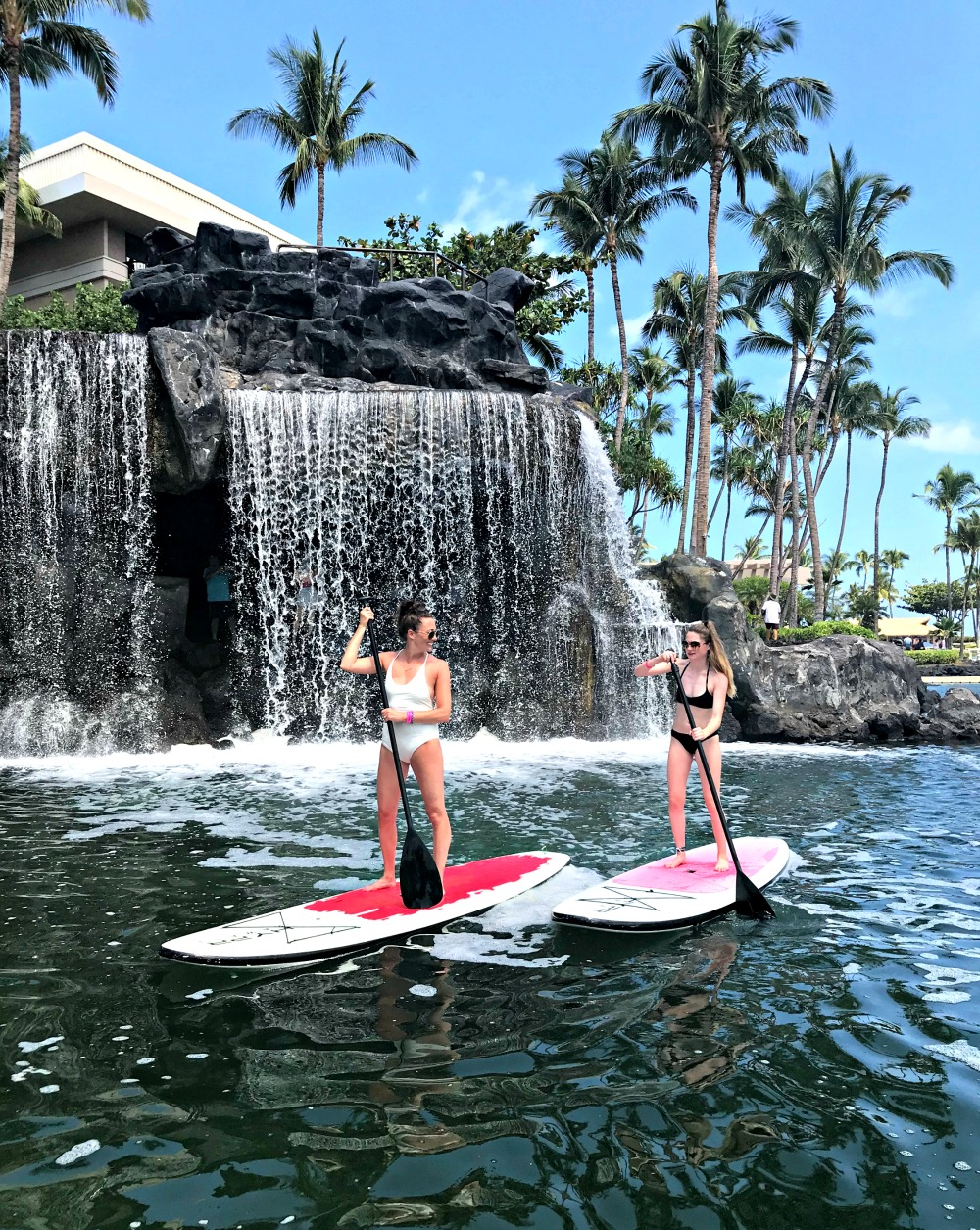 mother and daughter on paddleboards