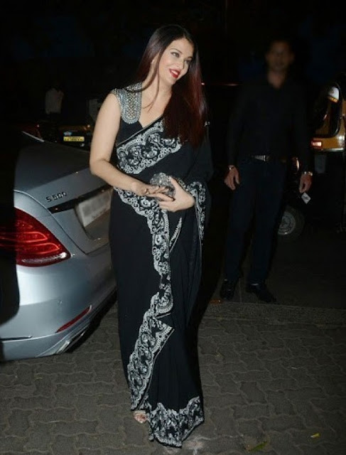 Aishwarya Rai Bachchan wearing a black saree