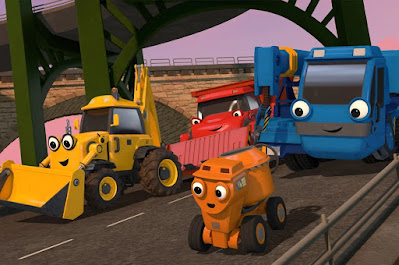 ID: Scoop the backhoe, Muck the bulldozer with a fitted dump bed, Dizzy the cement mixer, and Lofty the crane from Bob the Builder drive together along a paved road under an overpass.