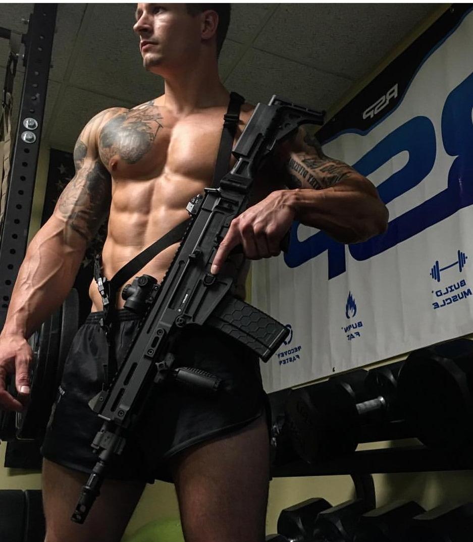 sexy-dangerous-shirtless-tattoo-musccle-hunk-armed-gun-veiny-arms-masculine-alpha-man-huge-pecs