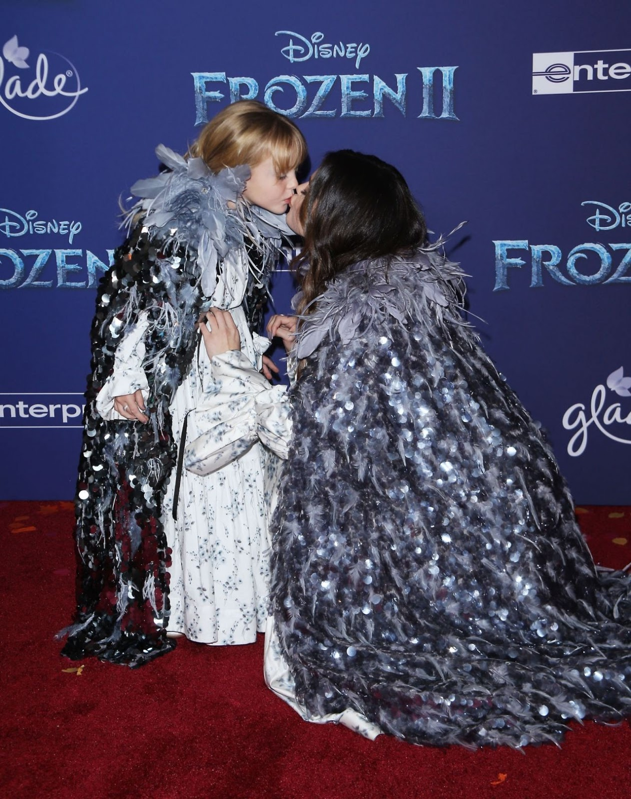 Selena Gomez, 27, plants a kiss on sister Gracie, six, as the two match in floral dresses and capes at the Frozen II premiere