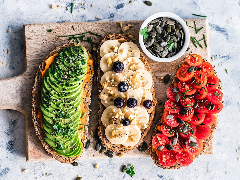 fruit and veg on toast on brown wooden chopping board - vegan at university