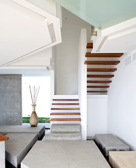 Photo of minimalist wooden staircase inside of the house