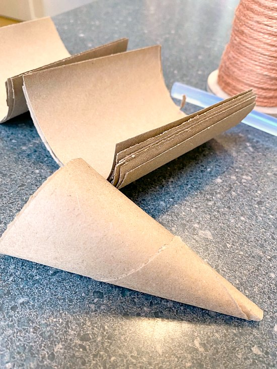 Rolling a cardboard cone for DIY Jute Carrots for Spring