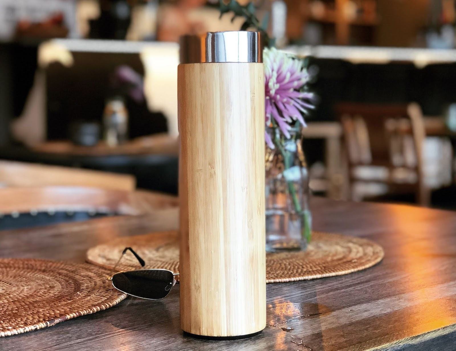 Reusable bamboo bottle for travel - sustainable travel guide - responsible traveler