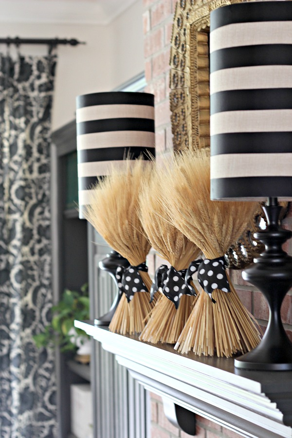 wheat bundles, polka dot ribbon, striped lampshades, gray cabinets and mantel