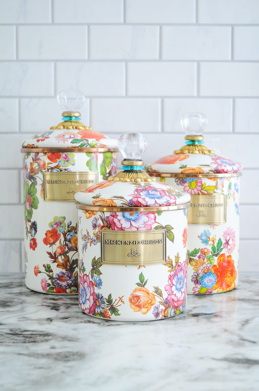 Gorgeous white, gold and floral kitchen canisters in a STUNNING white kitchen.