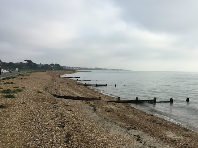A view along the shingle beach with a very dull sky