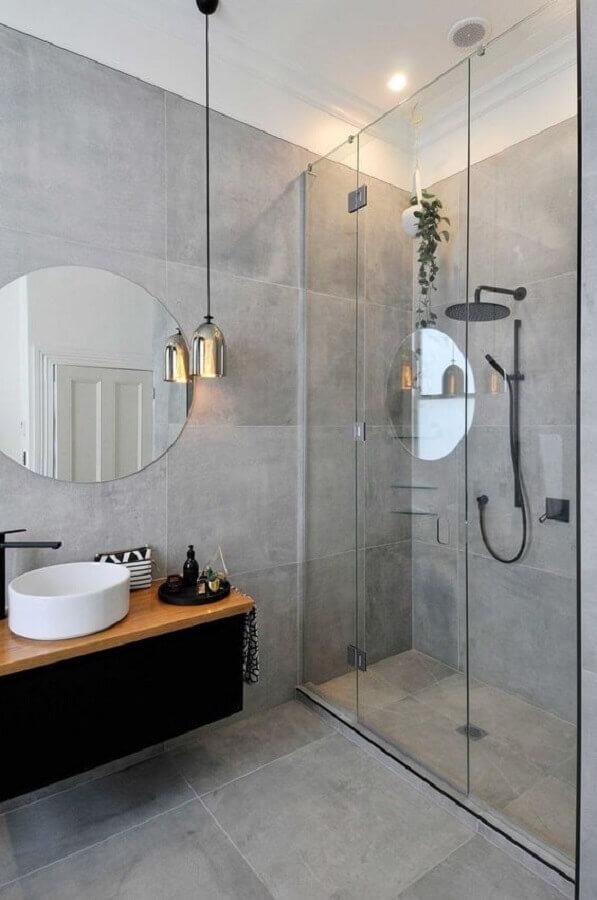 Modern gray bathroom decorated with round mirror