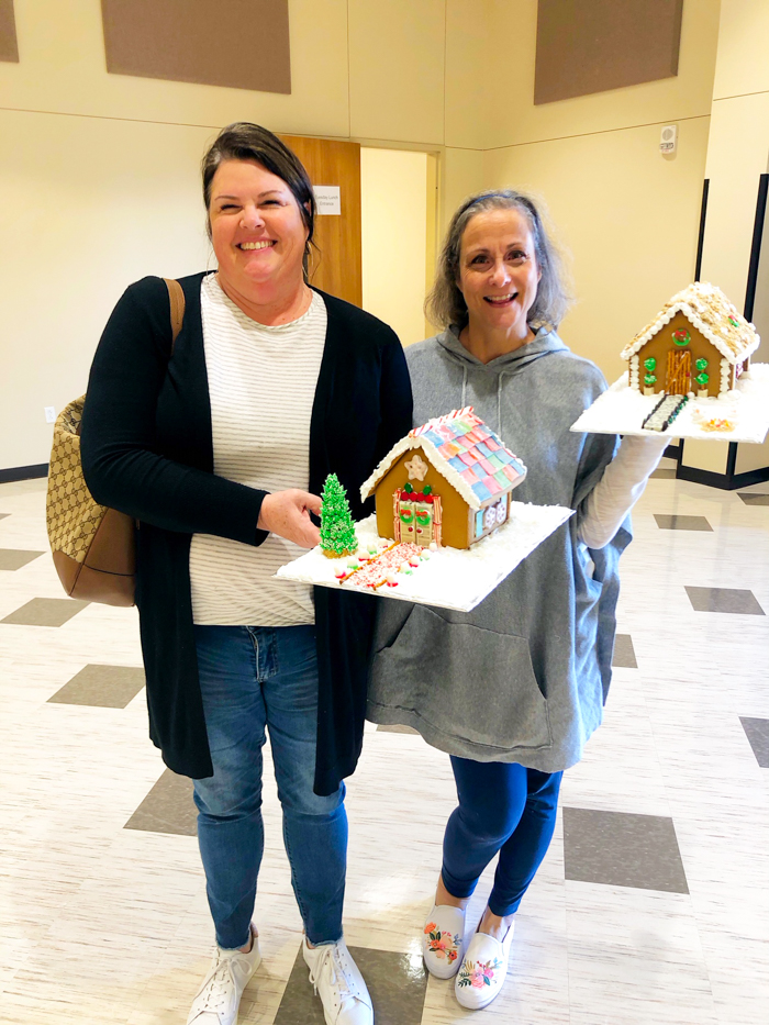 two sweet ladies with decorated gingerbread houses