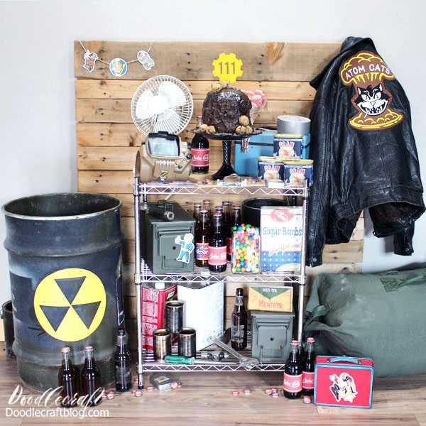 Alright! Let's get to this Vault-tacular party! Fallout 4 Party Supplies Needed: Scrap. Lots of scrap. Look around the house, garage, shed or grandpa's house. Gather anything with a 1950's vibe, plus some junk. Old paint cans, metal barrels, soup cans, desk fan, ammo boxes, gear bags, tool boxes, tools, old rotary phone, filing cabinet, beer bottles, bobby pins, bottle caps, wood pallets. Pretty much anything you could pick up in the game works.  Spam Bottle Caps Duct Tape Zeke's Atom Cats Jacket Soda Bottles with the cap lids Pip Boy Fallout Stickers Nuka Girl Lunchbox Chocolate Drip Cake Printer Cricut Machine Adhesive Now we'll go through some quick craft tutorials and I'll show you how to turn ordinary things into Vault Tech.