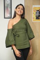 Pragya Jaiswal in a single Sleeves Off Shoulder Green Top Black Leggings promoting JJN Movie at Radio City 10.08.2017 064.JPG