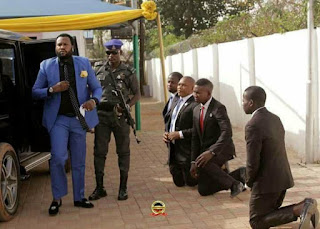 Warris This? Viral photos of Grown Men Kneeling To Welcome Their Pastor To Church In Abuja