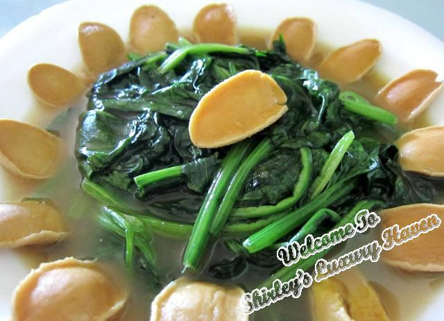 chinese new year limpet, baby abalone, spinach