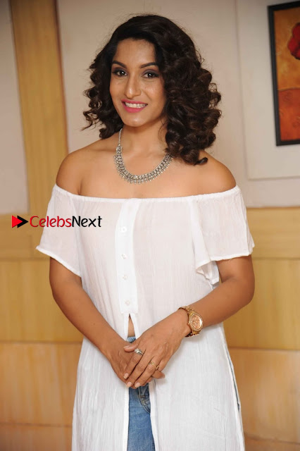 Kannada Model Actress Krishi Thapanda Stills in Ripped Jeans at Eradu Kanasu Movie Press Meet  0001.jpg