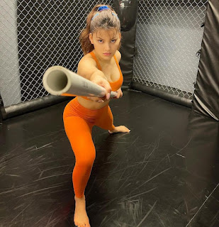 Do you wanna challenge Urvashi Rautela in Martial Arts, You would definitely lose  URVASHI RAUTELA,Bear Grylls,versace outfits,bend over,Airport look,K-pop artist Lisa,Best Actress Critics' Choice Award,THUMKA & JHATKA,shut up,Jai Anshul Ambani's private jet,BOSU BALL SQUAT,Hip Mobility session,Bōjutsu,Japanese Martial Arts,