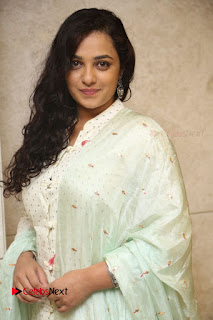 Actress Nithya Menen Latest Pictures in White Dress at 100 Days of Love Movie Audio Launch  0058
