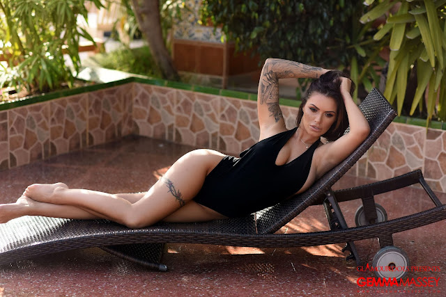 Gemma Massey playing with hairs sexy pose black bodysuit