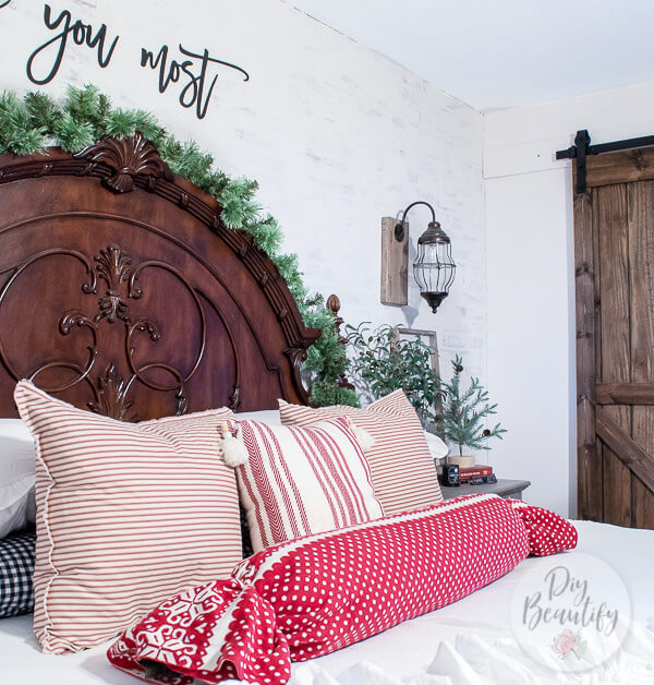 red striped pillows and carved headboard