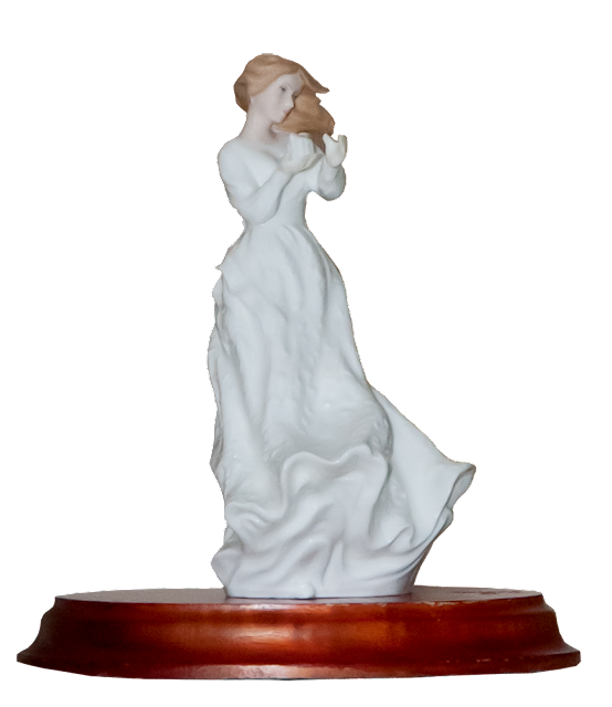 A Royal Doulton china figurine in a white flowing dress on a wooden stand.