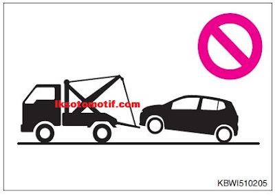 dilarang menderek mobil dengan truk sling