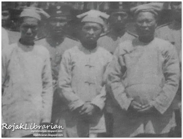 Ong Sam Kiat with his sons
