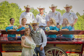 cowgirl and cowboy wedding party with burlap flowers