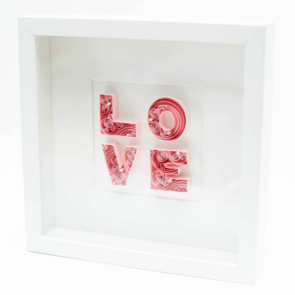 quilled pink block letters the spell LOVE in square white frame