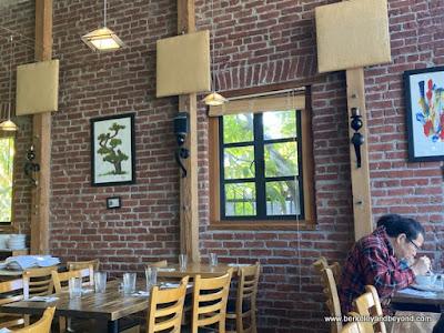 brick-wall interior of Anchalee Thai Cuisine in Berkeley, California