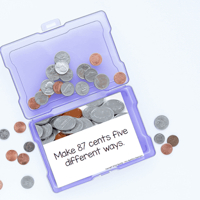 Photo of money task card and coins inside purple task card holder.