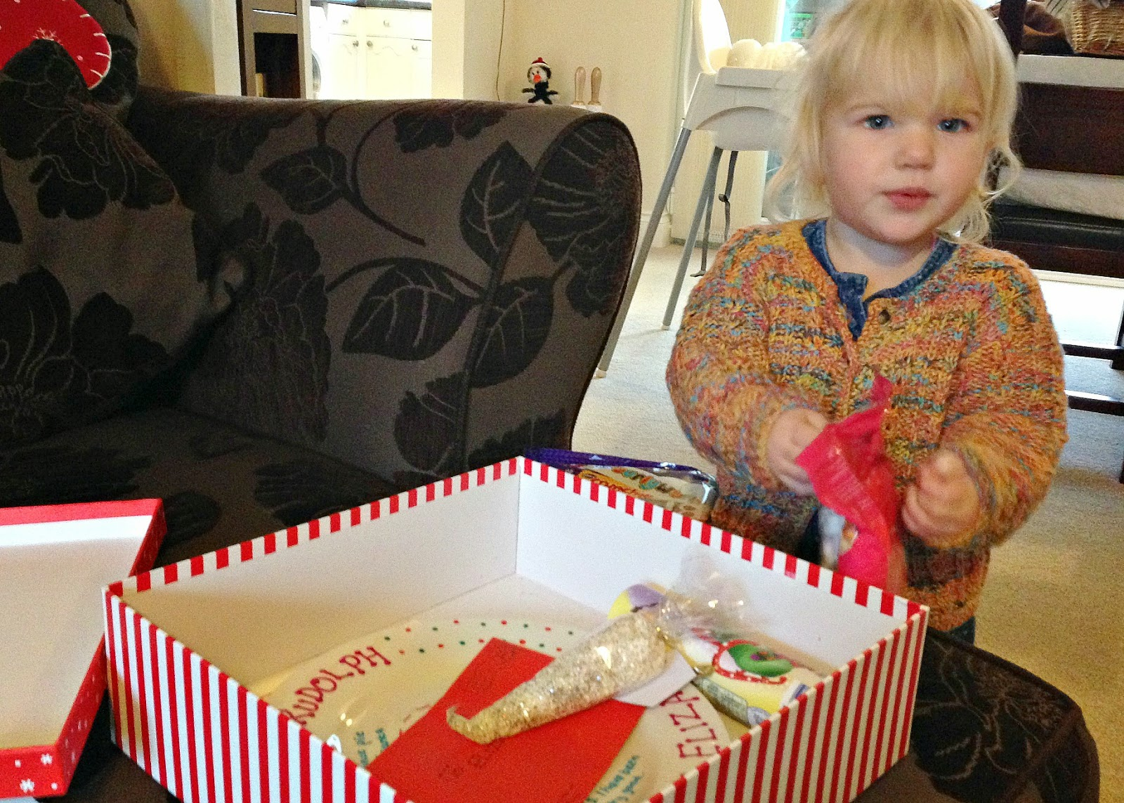 Tin Box Tot opens her Christmas Eve box