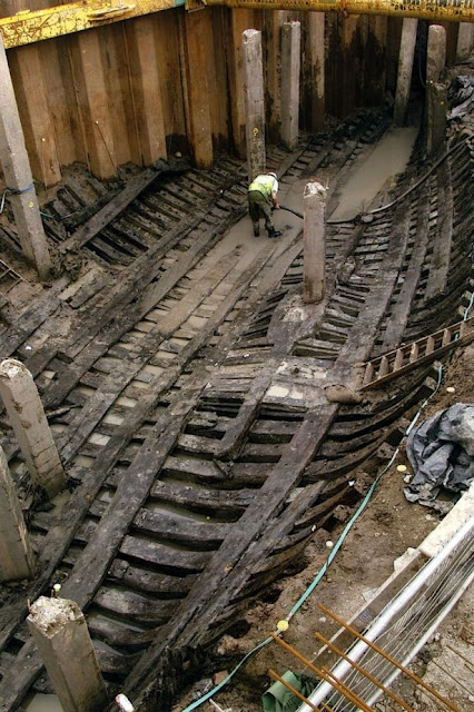 Large 15th century merchant vessel being put back together piece by piece