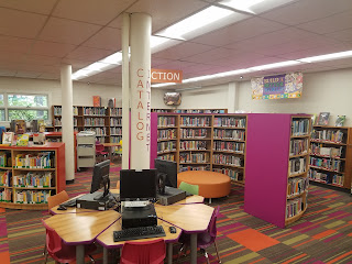 computers and bookshelves for children