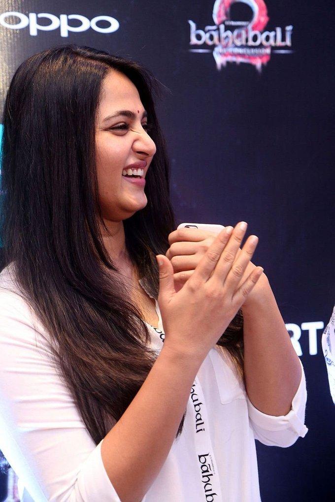 Bollywood Actress Anushka Shetty Long Hair Stills White Dress