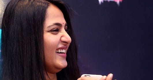 Tollywood Actress Anushka Shetty Long Hair Photos White Dress