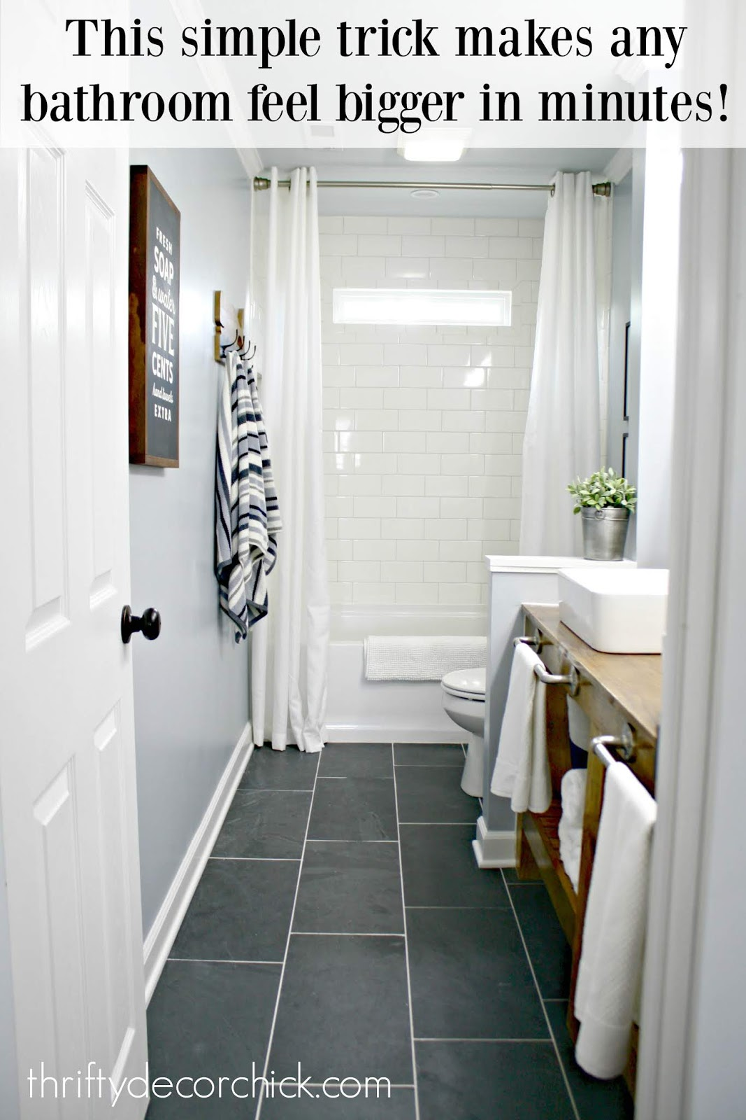 Raise shower curtain to make bathroom feel bigger