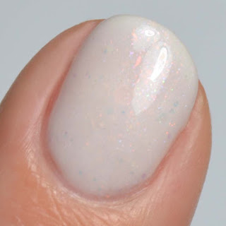 off white nail polish with opal glitter