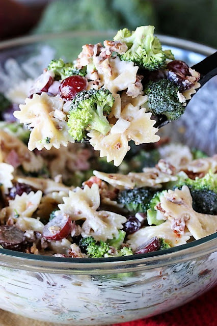 Serving Spoon of Broccoli Pasta Salad with Grapes Image