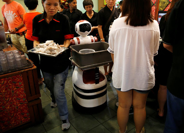 Image Attribute: A robot navigates its way to collect dirty dishes at Chilli Padi Nonya Cafe in Singapore July 6, 2016. Picture taken July 6, 2016. REUTERS/Edgar Su