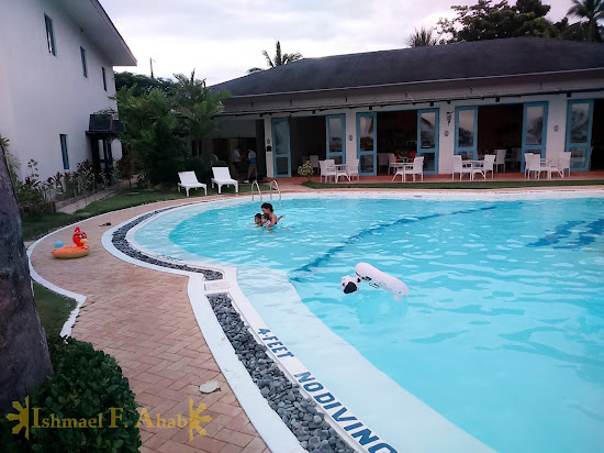 Swimming in Microtel Palawan, Puerto Princesa