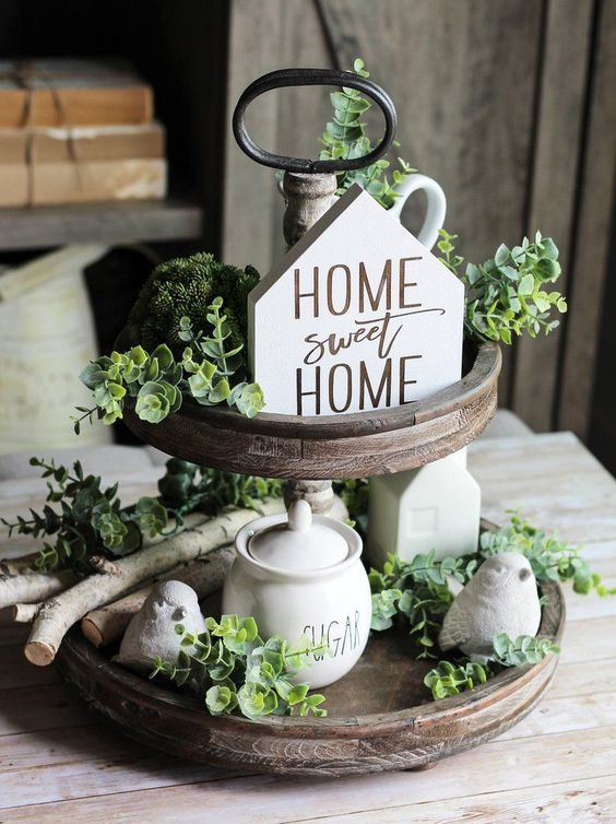 Two-tier wooden tray with greenery and home sweet home sign