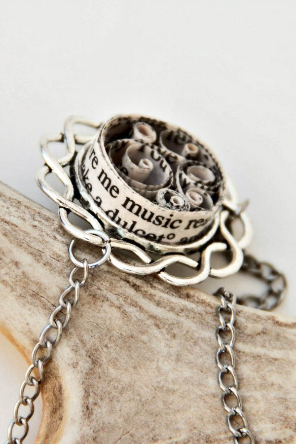 circular rolled book page paper necklace with silver metal base