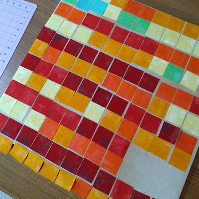 yello, orange and red squares of fabric