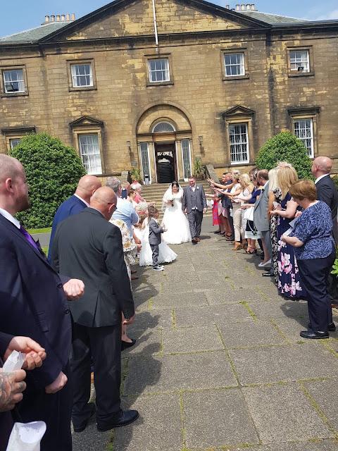 confetti wedding shot outside backworth hall
