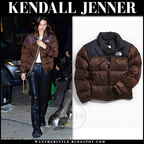 Kendall Jenner in brown north face retro nuptse puffer jacket and black trousers. Street style november 16